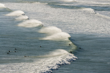 aerial view of surfers waiting for wave