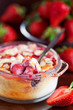 Clafoutis with strawberries and almonds, selective focus