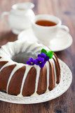 Chocolate bundt cake with icing, selective focus