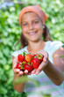 Girl holding a tomatoes
