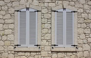 Wall of limestone masonry with windows