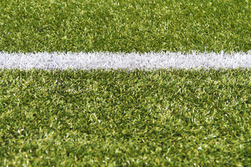 White stripe on a green artificial field