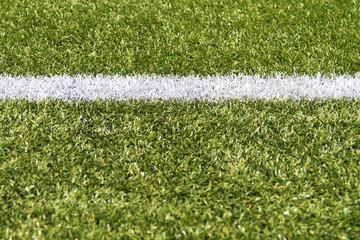 White stripe on a green artificial field