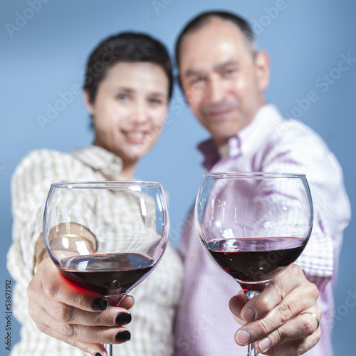 Couple toasting with a red wine