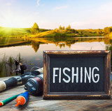 fishing tackle and a blackboard