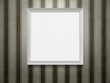Empty white wooden picture frame at grunge striped wall