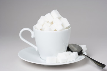 A cup full of sugar lumps