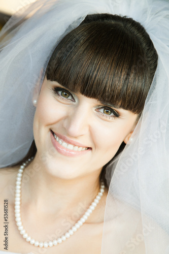 closeup of beautiful bride indoors with selective focus