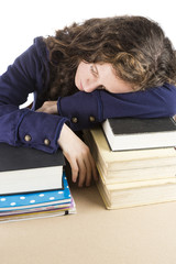 Teen sleeping on her books