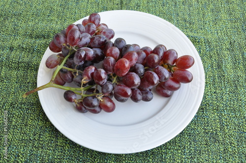 Bunch of grapes in white plate