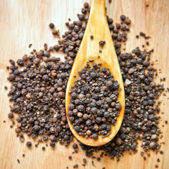 Black pepper peas on a wooden spoon