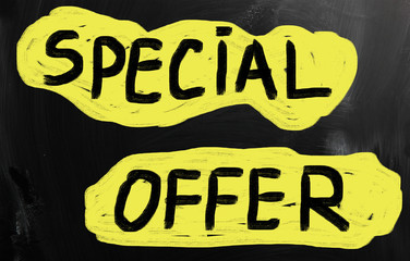 """Special offer"" handwritten with white chalk on a blackboard"