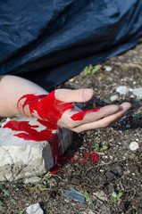 Close up view of bloody hand. Crime scene