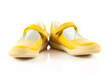 Children's shoes isolated over the white background.  yellow  sh