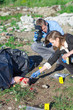 Two criminalists working on a crime scene