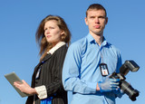 Two young criminalists on a sky background