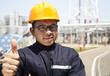 Asian industrial engineer showing thumb up