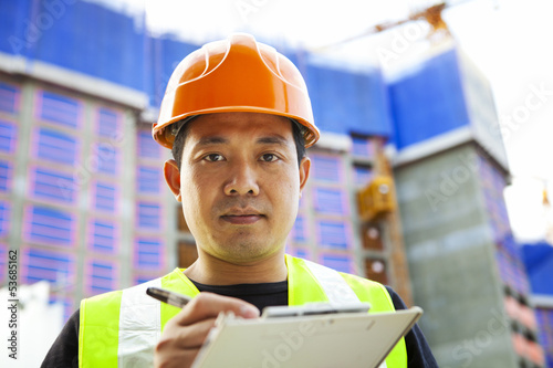 Portrait of asian builder
