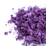 Crushed purple eye shadow on white background