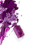 Purple nail polish and crushed eye shadow on white background