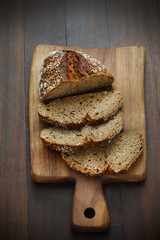 Spelt whole-grainflour bread, sliced on a board, breakfast