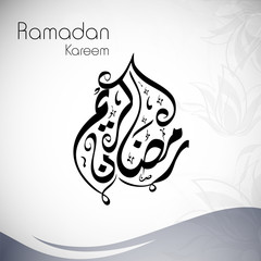 Arabic Islamic calligraphy of text Ramadan Kareem on abstract gr