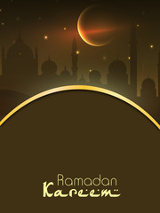 Ramadan Kareem background with view of mosque in shiny moonlight