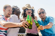 Friends at a beach party having drinks