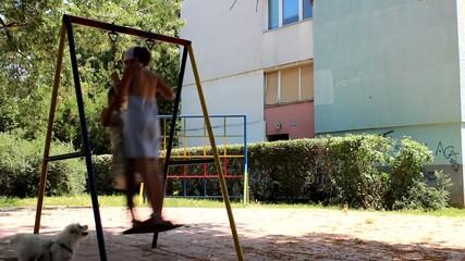 Two girls,one swing