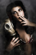 Vintage army pinup girl holding gas mask