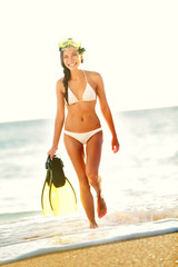 Beach woman snorkeling walking happy