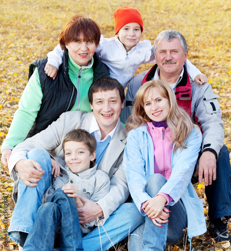 Big family in autumn park
