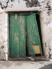 Old flaking broken green door in Fuerteventura Canary Islands