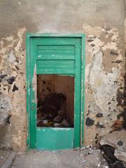 Old flaking door in white wall in Fuerteventura Canary Islands