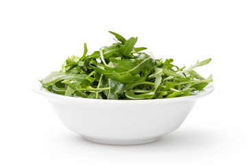 fresh rucola leaves in a bowl
