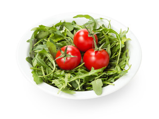 ruccola and tomatoes in white bowl