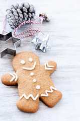 Cute gingerbread man with cookie cutter