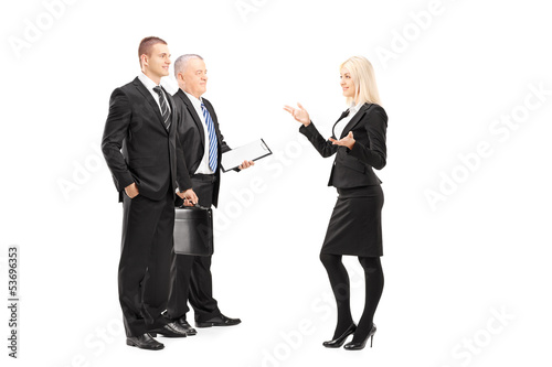 Full length portrait of businessmen and businesswoman having a c
