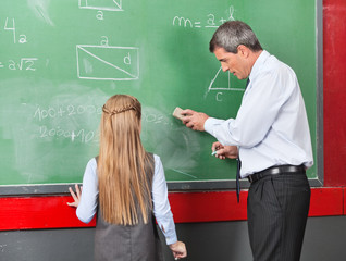 Professor Teaching Mathematics To Little Girl On Board