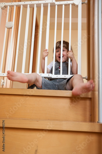 baby approaching safety gate
