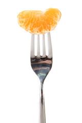 Tangerine slice on fork, isolated on white