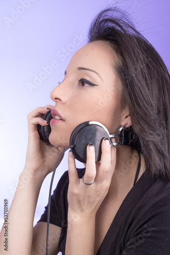 portrait of woman with headphones music