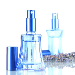Perfume in bottles and lavender isolated on white