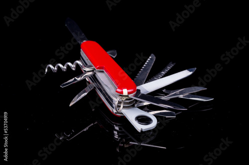 Swiss knife on black background