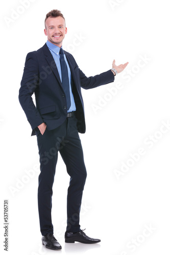 business man presents with hand in pocket