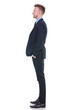 business man stands sideways and smiles