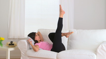 Chinese woman moving her legs on couch