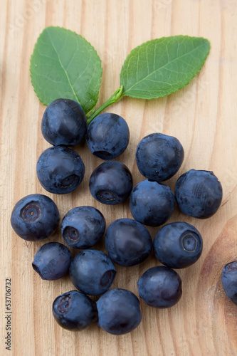 Blueberries on a wooden table.