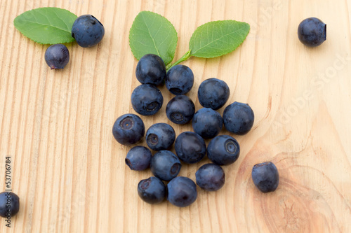 Fresh blueberries  on a wooden table.