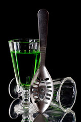 Glass of absinthe and absinthe spoon